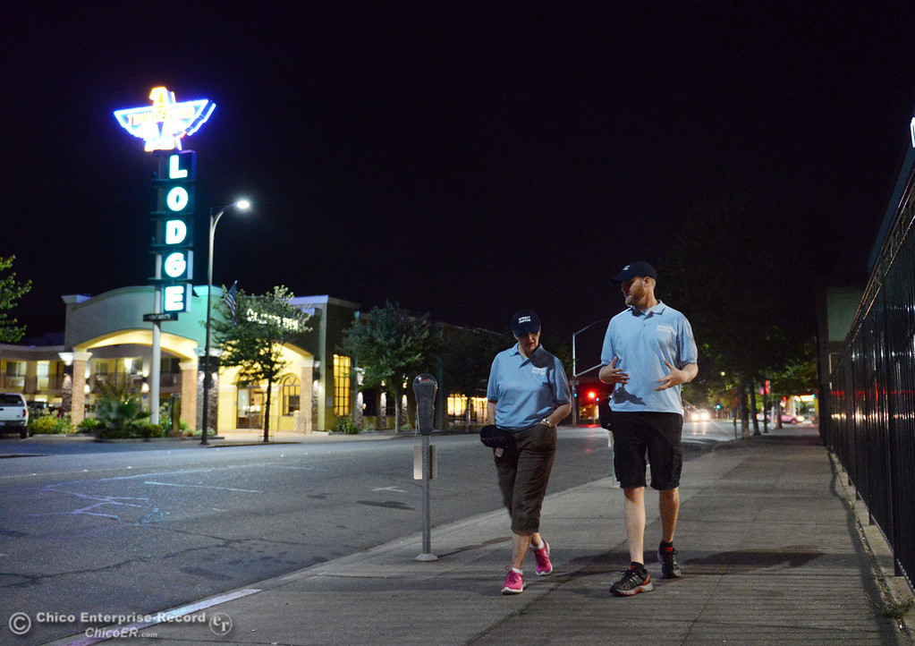 Description of . Nancy Calkins, and Jeremy Rhodes (left to right) walked around downtown Chico with others that were part of the Street Pastors program Friday, August 23, 2013 in Chico, Calif.  (Jason Halley/Chico Enterprise-Record)