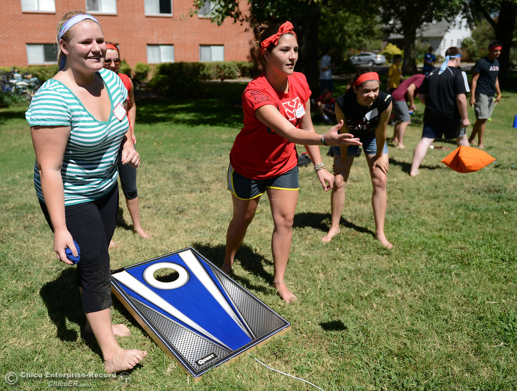 Description of . Chico State students Sam Duncan, 21 (left) and Carla Bravo, 21 (right) play games as alternative activities to floating on the Sacramento River for Labor Day at the Wildcat Challenge event on the lawn between Lassen Hall and Sutter Hall on the Chico State Campus Saturday, August 31, 2013 in Chico, Calif.  (Jason Halley/Chico Enterprise-Record)
