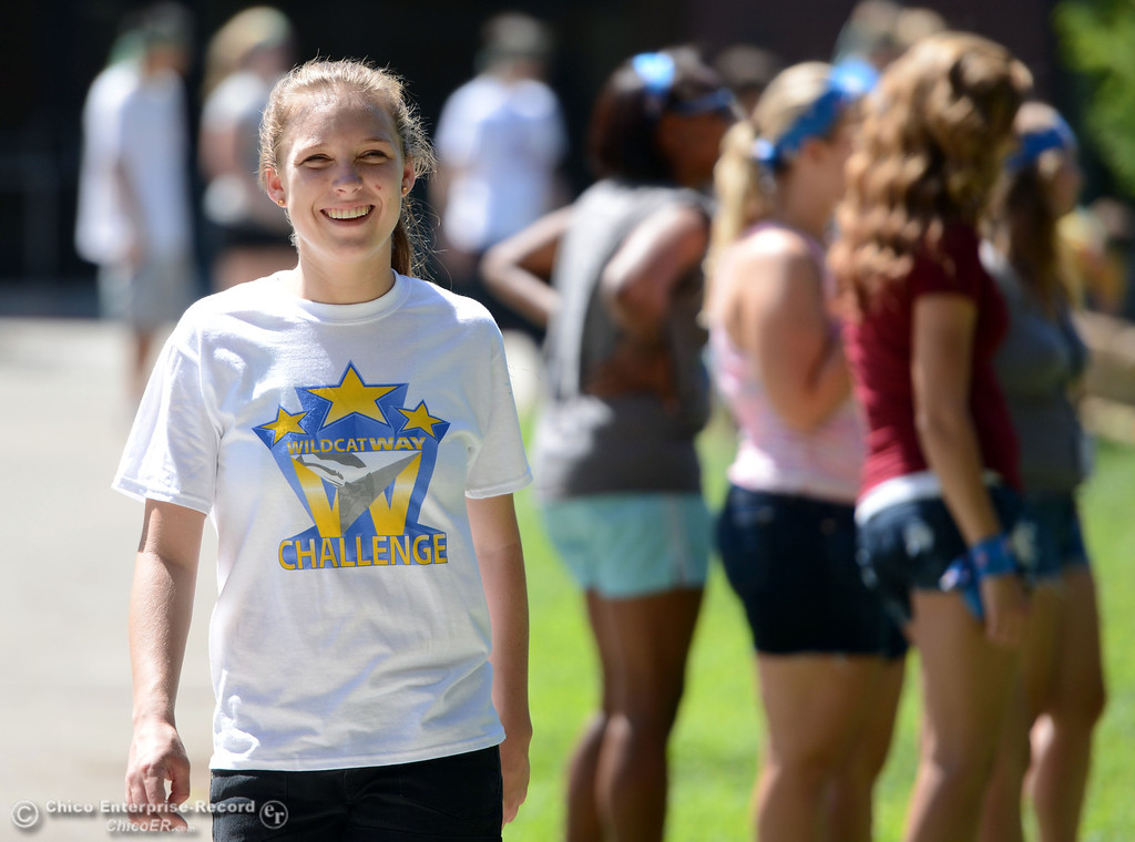 Description of . Chico State A.S. President Taylor Herren watches students play games as alternative activities to floating on the Sacramento River for Labor Day at the Wildcat Challenge event on the lawn between Lassen Hall and Sutter Hall on the Chico State Campus Saturday, August 31, 2013 in Chico, Calif.  (Jason Halley/Chico Enterprise-Record)
