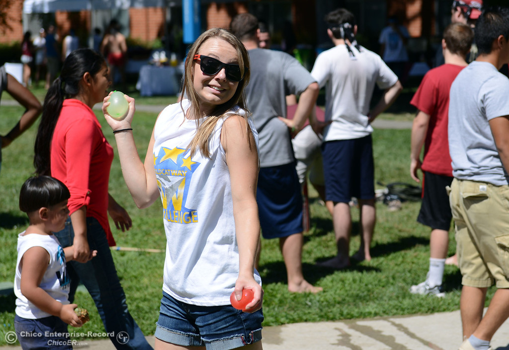 Description of . Chico State student Michaela Leonard, 19 gets ready to throw a water balloon as they play games as alternative activities to floating on the Sacramento River for Labor Day at the Wildcat Challenge event on the lawn between Lassen Hall and Sutter Hall on the Chico State Campus Saturday, August 31, 2013 in Chico, Calif.  (Jason Halley/Chico Enterprise-Record)