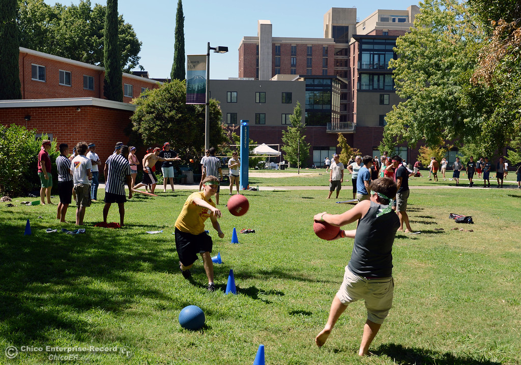 Description of . Chico State students  Danny Phelan, 18 (left) throws a ball at Zachary Hoffman, 18 (right) as they play dodgeball and other games as alternative activities to floating on the Sacramento River for Labor Day at the Wildcat Challenge event on the lawn between Lassen Hall and Sutter Hall on the Chico State Campus Saturday, August 31, 2013 in Chico, Calif.  (Jason Halley/Chico Enterprise-Record)