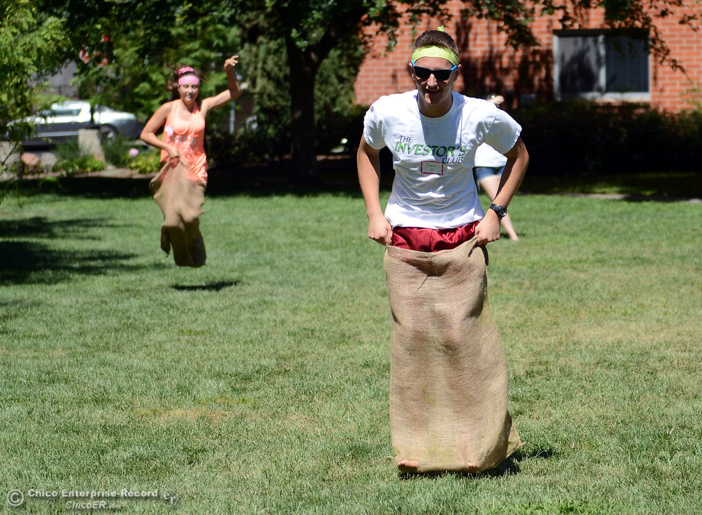 Description of . Chico State students Charlie Curtis, 19 (right) races Shelby Craig, 19 (left) in a sack race as an alternative activity to floating on the Sacramento River for Labor Day at the Wildcat Challenge event on the lawn between Lassen Hall and Sutter Hall on the Chico State Campus Saturday, August 31, 2013 in Chico, Calif.  (Jason Halley/Chico Enterprise-Record)