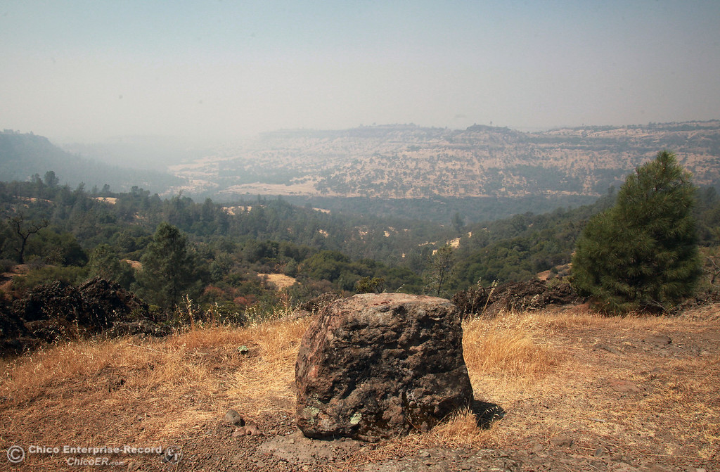 Description of . A view of a upper Bidwell Park along Hwy 32 as smoke from the Chips Fire lingers in the valley on August 10, 2012.  (Jason Halley /Chico Enterprise-Record)