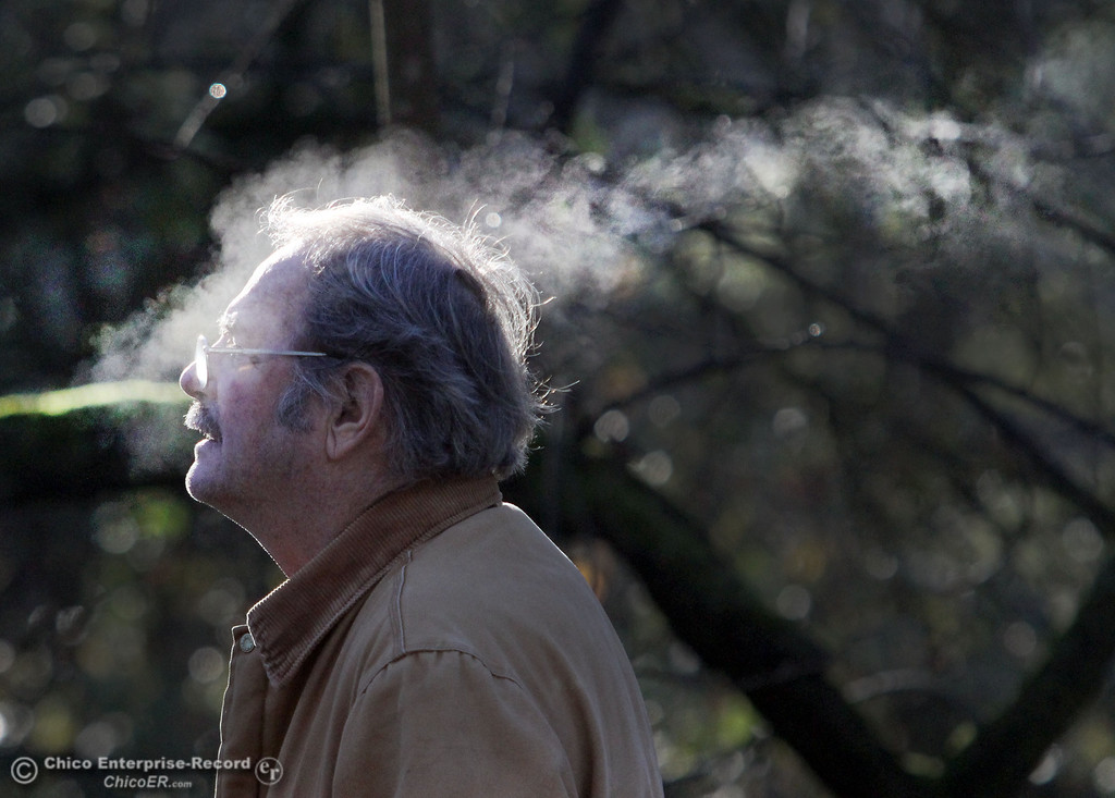 Description of . Don Noonan breathes out a breath of steam as cold temperatures brought a small layer of frost into lower Bidwell Park on December 27, 2012 in Chico, Calif. (Jason Halley/Enterprise-Record)