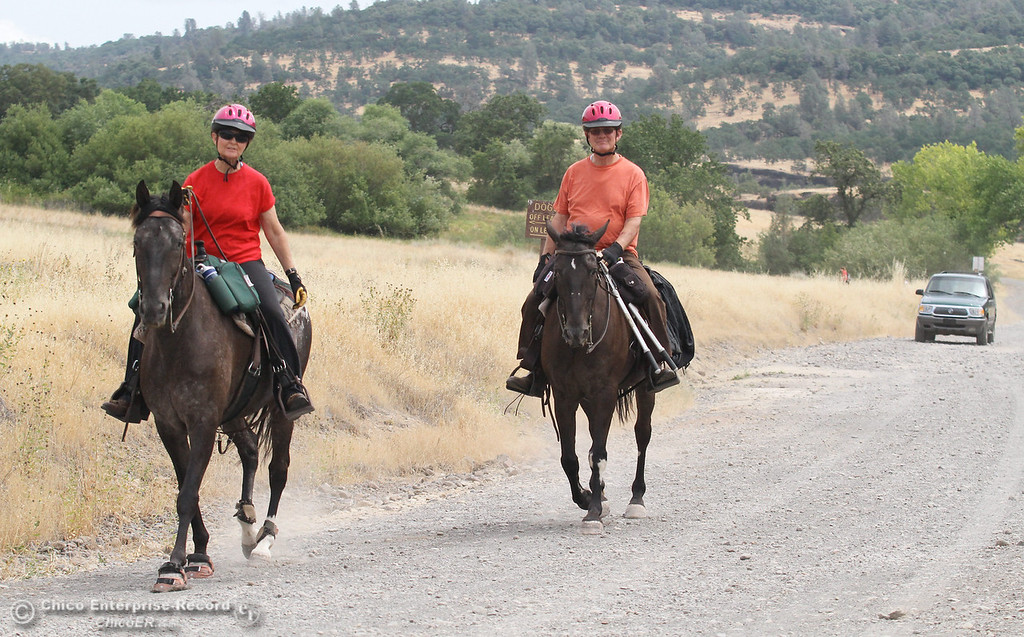 Description of . Dean and Judy Halladay, of Chico, ride their horses