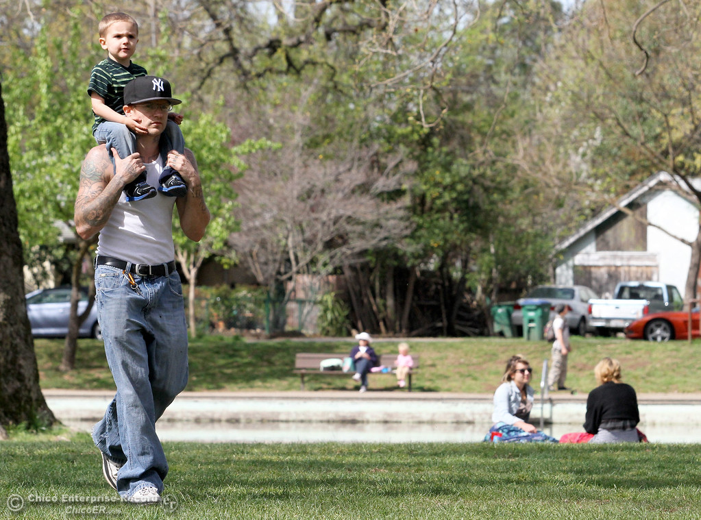 Description of . Gabriel Sherrill, 2, gets a ride on Don Sherrill's shoulders in lower Bidwell Park on March 18, 2013. Don said