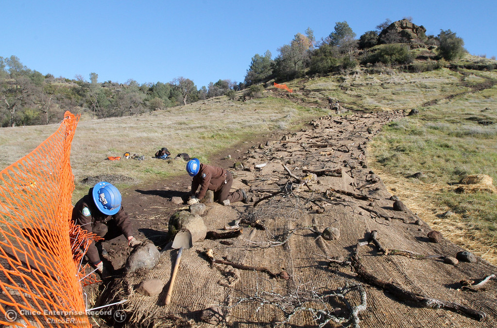 Description of . California Conservation Corps. members continue work on the trail up to Monkey Face in upper Bidwell Park on January 10, 2013. (Bill Husa/Chico Enterprise-Record)