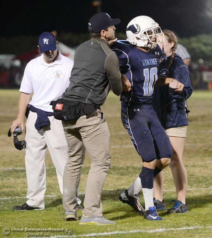 Description of . Pleasant Valley High\'s #10 Tucker LaRue is picked up after a hard hit against Chico High in the second quarter of their Almond Bowl football game at CSUC University Stadium Friday, November 1, 2013 in Chico, Calif.  (Jason Halley/Chico Enterprise-Record)