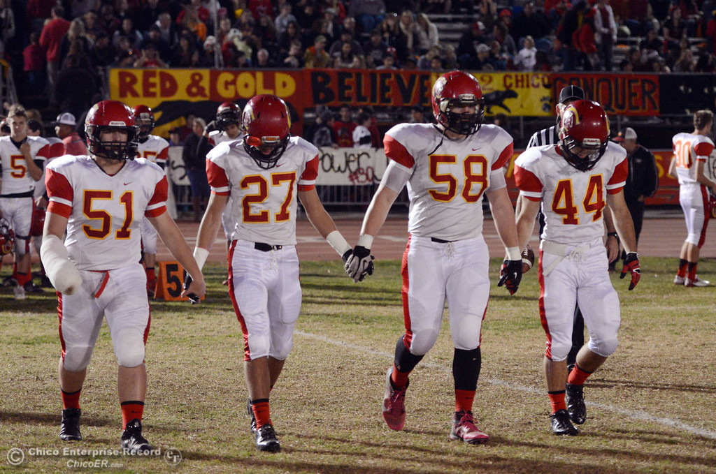 Description of . Chico High\'s #51 Kody Sonday, #27 Noah Collado, #58 Malik Hopkins, and #44 Cyland Leitner (left to right) come out for the coin toss against Pleasant Valley High in the first quarter of their Almond Bowl football game at CSUC University Stadium Friday, November 1, 2013 in Chico, Calif.  (Jason Halley/Chico Enterprise-Record)