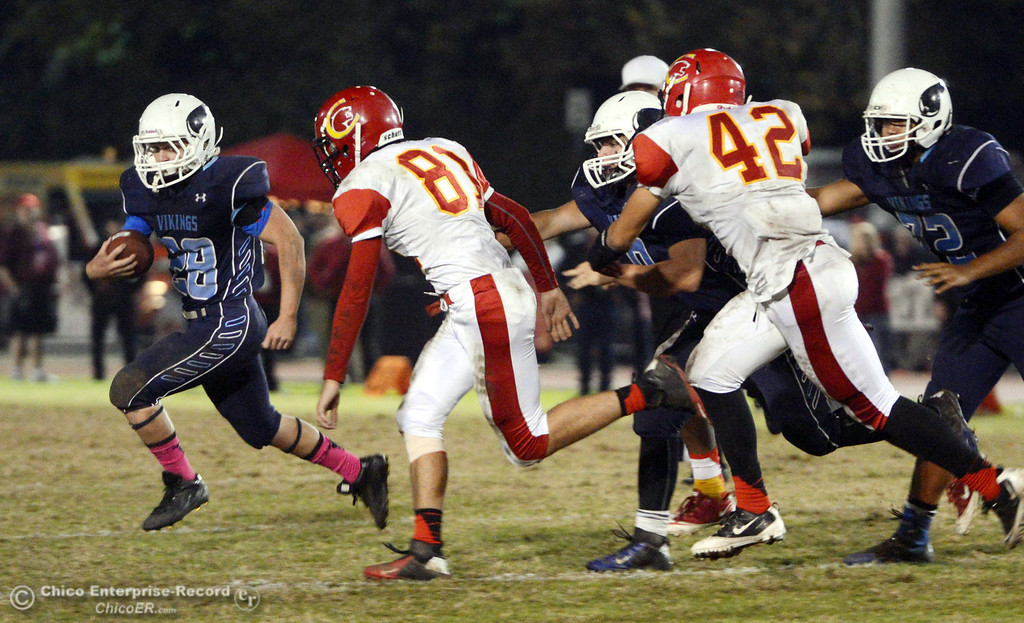 Description of . Pleasant Valley High\'s #28 Dylan Batie (left) rushes against Chico High\'s #81 Nathan Heyl (right) in the second quarter of their Almond Bowl football game at CSUC University Stadium Friday, November 1, 2013 in Chico, Calif.  (Jason Halley/Chico Enterprise-Record)