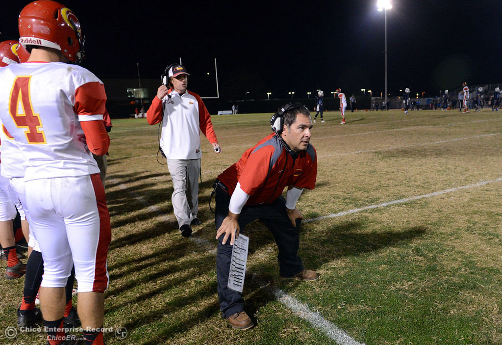 Description of . Chico High head coach Jason Alvistur looks on against Pleasant Valley High in the fourth quarter of their Almond Bowl football game at CSUC University Stadium Friday, November 1, 2013 in Chico, Calif.  (Jason Halley/Chico Enterprise-Record)
