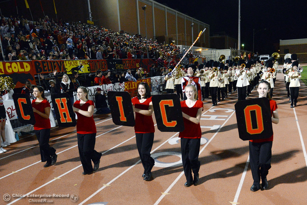 Description of . Chico High band comes onto the field against Pleasant Valley High in the first quarter of their Almond Bowl football game at CSUC University Stadium Friday, November 1, 2013 in Chico, Calif.  (Jason Halley/Chico Enterprise-Record)