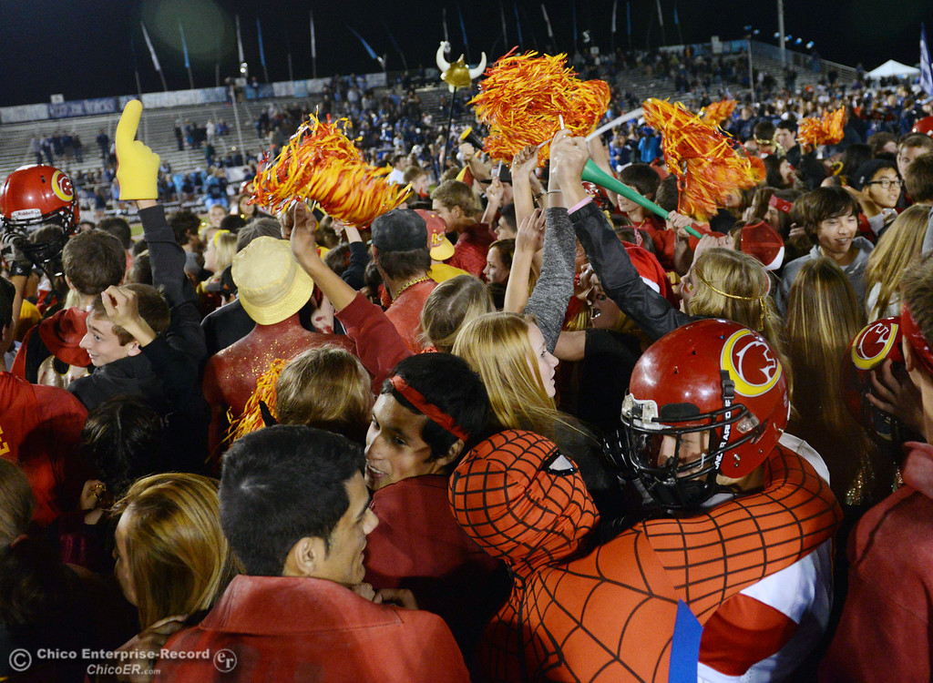 Description of . Chico High fan wearing a Spiderman costume celebrates their win against  Pleasant Valley High at the end of the fourth quarter of their Almond Bowl football game at CSUC University Stadium Friday, November 1, 2013 in Chico, Calif.  (Jason Halley/Chico Enterprise-Record)