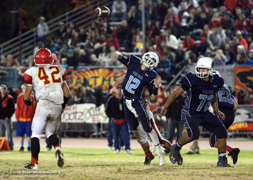Description of . Pleasant Valley High\'s #12 Trent Darms (right) throws a pass against Chico High in the third quarter of their Almond Bowl football game at CSUC University Stadium Friday, November 1, 2013 in Chico, Calif.  (Jason Halley/Chico Enterprise-Record)