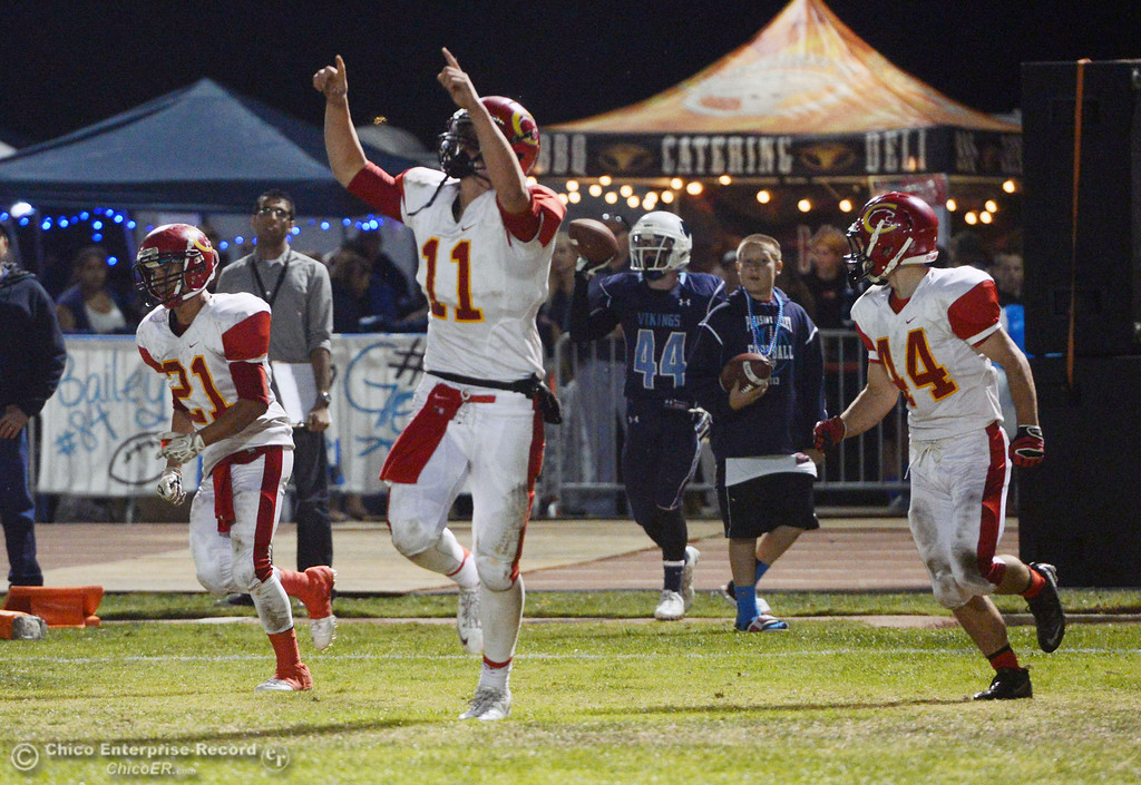 Description of . Chico High\'s #11 Clayton Welch scores a touchdown against Pleasant Valley High in the second quarter of their Almond Bowl football game at CSUC University Stadium Friday, November 1, 2013 in Chico, Calif.  (Jason Halley/Chico Enterprise-Record)