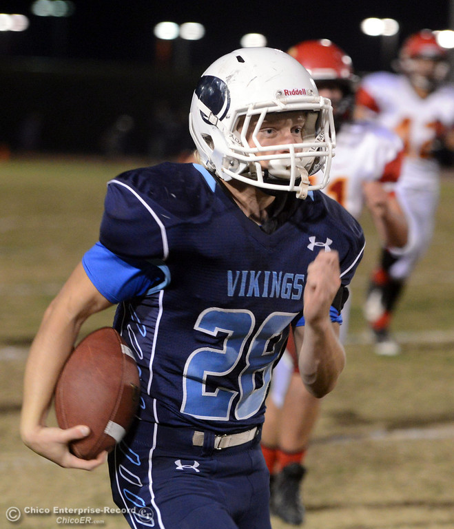 Description of . Pleasant Valley High\'s #28 Dylan Batie rushes for a touchdown against Chico High in the first quarter of their Almond Bowl football game at CSUC University Stadium Friday, November 1, 2013 in Chico, Calif.  (Jason Halley/Chico Enterprise-Record)