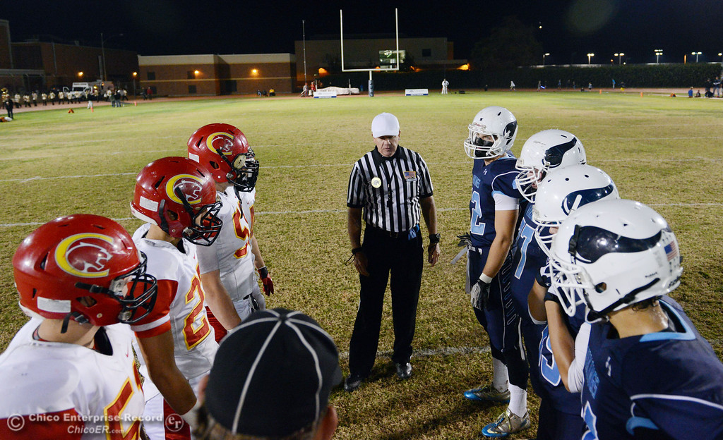 Description of . Chico High\'s #51 Kody Sonday, #27 Noah Collado, #58 Malik Hopkins, and #44 Cyland Leitner come out for the coin toss against Pleasant Valley High\'s #42 Chad Olsen, #77 Tyler Stimac, #35 Benjamin Whitmore, and #24 Jack Soza (left to right) in the first quarter of their Almond Bowl football game at CSUC University Stadium Friday, November 1, 2013 in Chico, Calif.  (Jason Halley/Chico Enterprise-Record)
