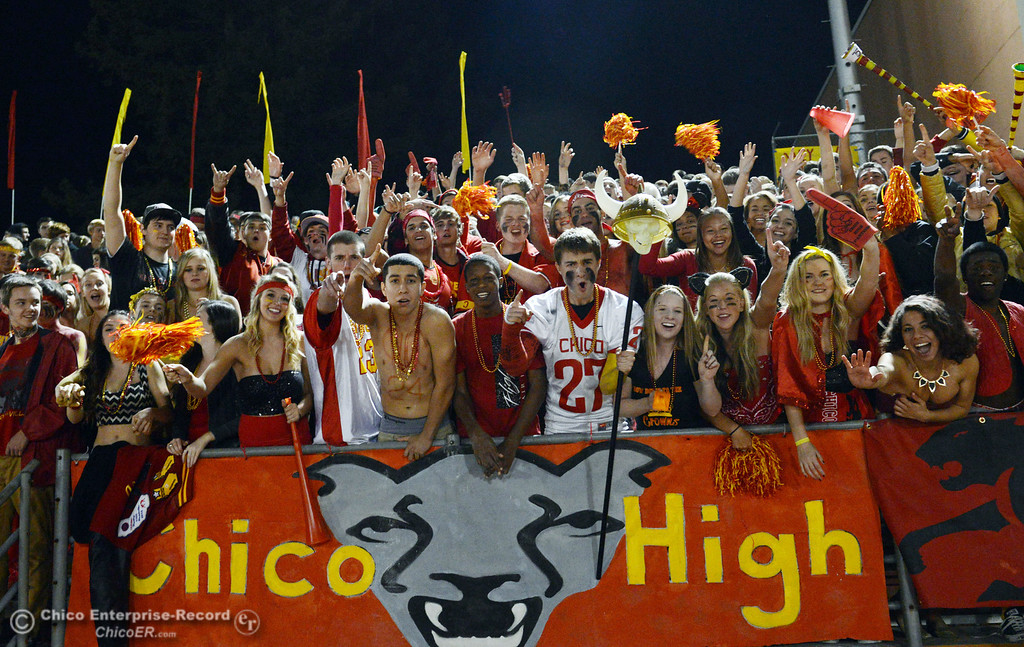 Description of . Chico High fans cheer on against Pleasant Valley High in the first quarter of their Almond Bowl football game at CSUC University Stadium Friday, November 1, 2013 in Chico, Calif.  (Jason Halley/Chico Enterprise-Record)