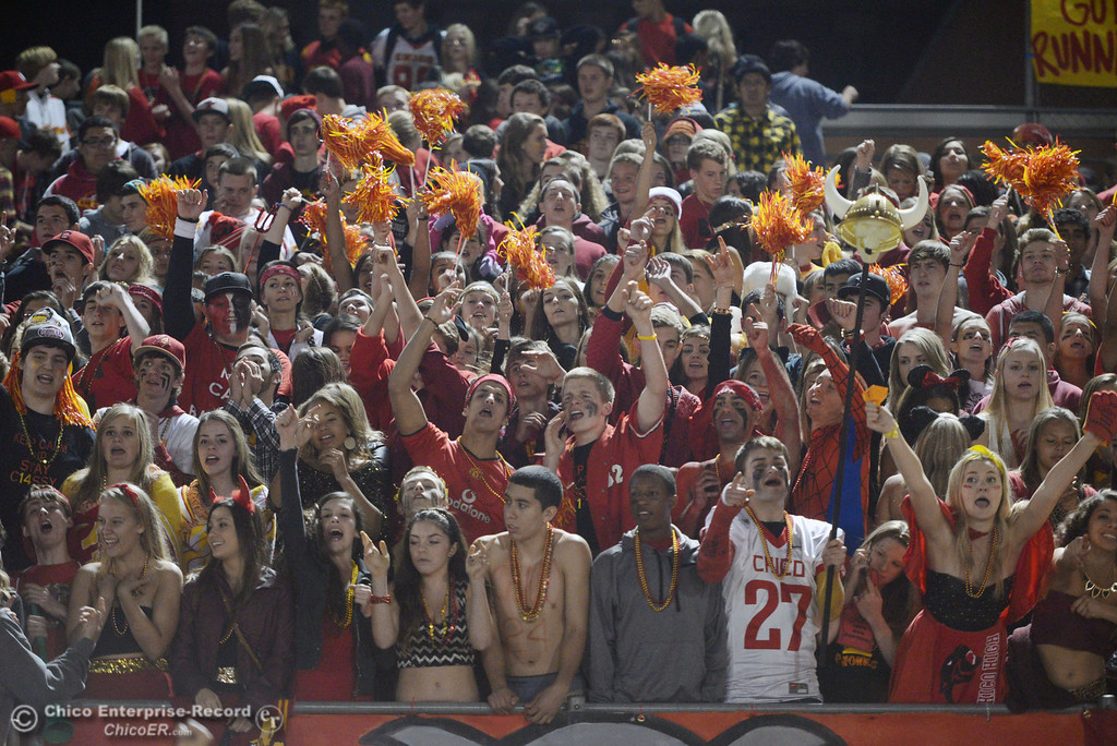 Description of . Chico High fans cheer on against Pleasant Valley High in the fourth quarter of their Almond Bowl football game at CSUC University Stadium Friday, November 1, 2013 in Chico, Calif.  (Jason Halley/Chico Enterprise-Record)