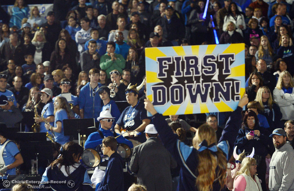Description of . Pleasant Valley High cheerleader puts up a sign against Chico High in the second quarter of their Almond Bowl football game at CSUC University Stadium Friday, November 1, 2013 in Chico, Calif.  (Jason Halley/Chico Enterprise-Record)