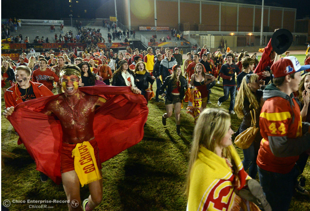 Description of . Chico High fans celebrate their win against  Pleasant Valley High at the end of the fourth quarter of their Almond Bowl football game at CSUC University Stadium Friday, November 1, 2013 in Chico, Calif.  (Jason Halley/Chico Enterprise-Record)