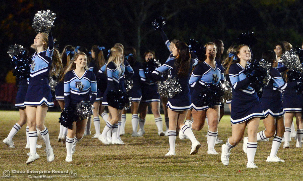Description of . Pleasant Valley High cheerleaders perform during halftime of their Almond Bowl football game against Chico High at CSUC University Stadium Friday, November 1, 2013 in Chico, Calif.  (Jason Halley/Chico Enterprise-Record)