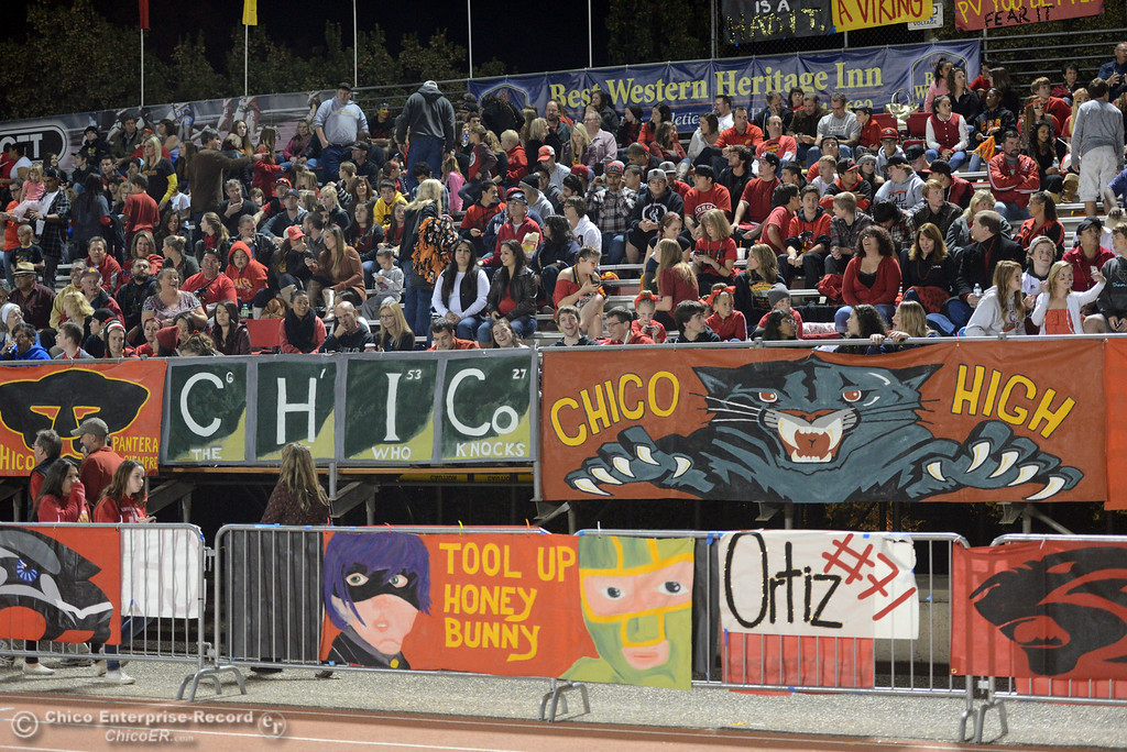 Description of . Chico High fans sit in the stands against Pleasant Valley High in the first quarter of their Almond Bowl football game at CSUC University Stadium Friday, November 1, 2013 in Chico, Calif.  (Jason Halley/Chico Enterprise-Record)