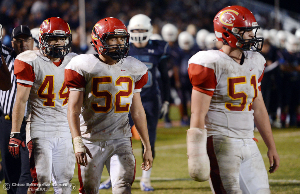 Description of . Chico High\'s #44 Paolo DiSano, #52 Chad Farrell, and #51 Kody Sonday (left to right) against Pleasant Valley High in the third quarter of their Almond Bowl football game at CSUC University Stadium Friday, November 1, 2013 in Chico, Calif.  (Jason Halley/Chico Enterprise-Record)