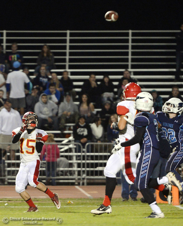Description of . Chico High\'s #15 Miles Fishback makes a catch against Pleasant Valley High in the first quarter of their Almond Bowl football game at CSUC University Stadium Friday, November 1, 2013 in Chico, Calif.  (Jason Halley/Chico Enterprise-Record)