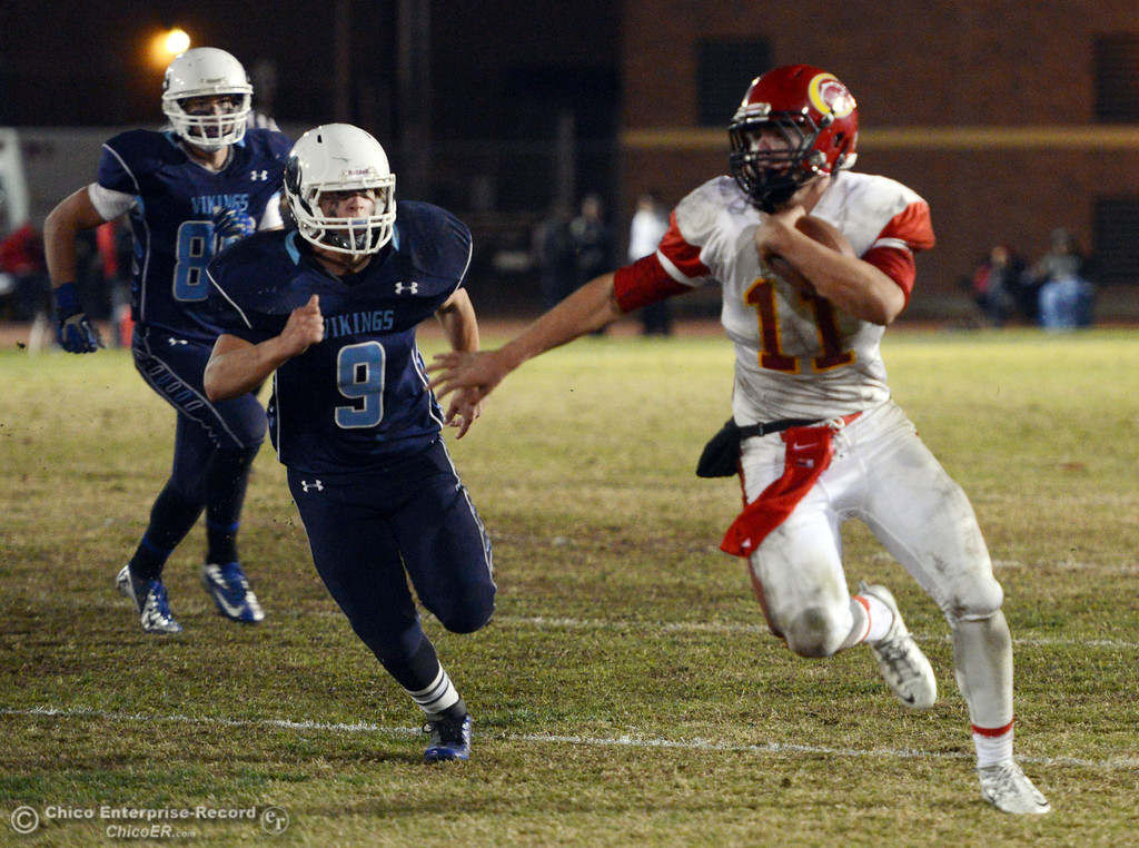 Description of . Chico High\'s #11 Clayton Welch (right) runs for a touchdown against Pleasant Valley High\'s #9 Houston McGowan (left) in the third quarter of their Almond Bowl football game at CSUC University Stadium Friday, November 1, 2013 in Chico, Calif.  (Jason Halley/Chico Enterprise-Record)
