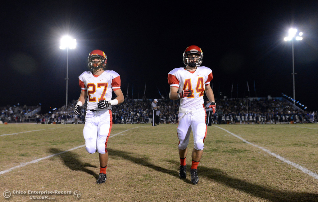 Description of . Chico High\'s #27 Noah Collado (left) and #44 Paolo DiSano (right) against Pleasant Valley High in the first quarter of their Almond Bowl football game at CSUC University Stadium Friday, November 1, 2013 in Chico, Calif.  (Jason Halley/Chico Enterprise-Record)