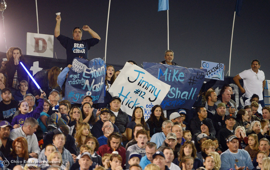 Description of . Pleasant Valley High fans cheer on against Chico High in the first quarter of their Almond Bowl football game at CSUC University Stadium Friday, November 1, 2013 in Chico, Calif.  (Jason Halley/Chico Enterprise-Record)