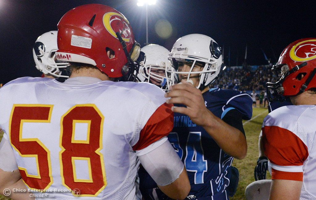 Description of . Chico High\'s #58 Malik Hopkins (left)  greets Pleasant Valley High\'s #24 Jack Soza (right) in the first quarter of their Almond Bowl football game at CSUC University Stadium Friday, November 1, 2013 in Chico, Calif.  (Jason Halley/Chico Enterprise-Record)