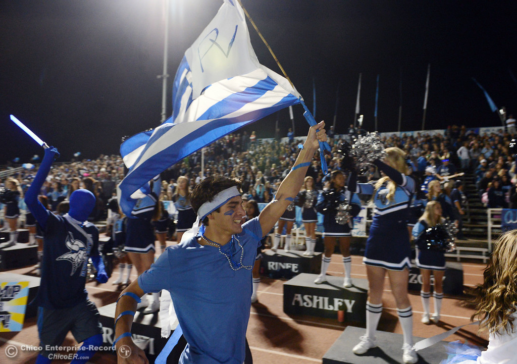 Description of . Pleasant Valley High fans run down the track to cheer on against Chico High in the second quarter of their Almond Bowl football game at CSUC University Stadium Friday, November 1, 2013 in Chico, Calif.  (Jason Halley/Chico Enterprise-Record)