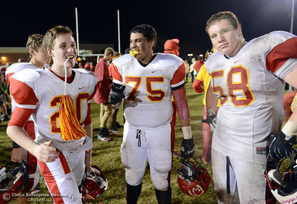 Description of . Chico High\'s #20 Marcus Schwab, #75 Raja Nijim, and #58 Malik Hopkins (left to right) celebrate their win against Pleasant Valley High at the end of the fourth quarter of their Almond Bowl football game at CSUC University Stadium Friday, November 1, 2013 in Chico, Calif.  (Jason Halley/Chico Enterprise-Record)
