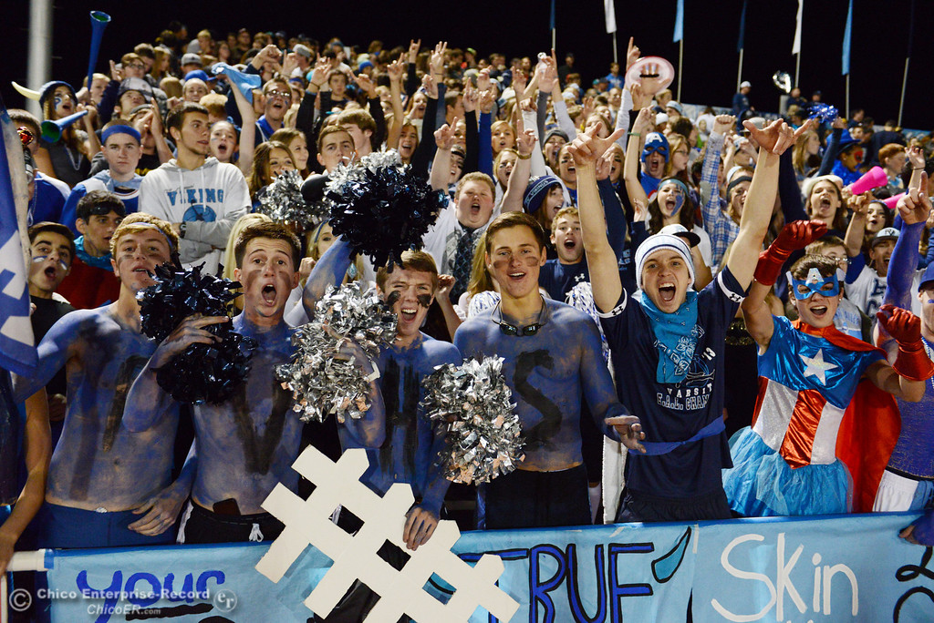 Description of . Pleasant Valley High fans cheer on against Chico High in the second quarter of their Almond Bowl football game at CSUC University Stadium Friday, November 1, 2013 in Chico, Calif.  (Jason Halley/Chico Enterprise-Record)