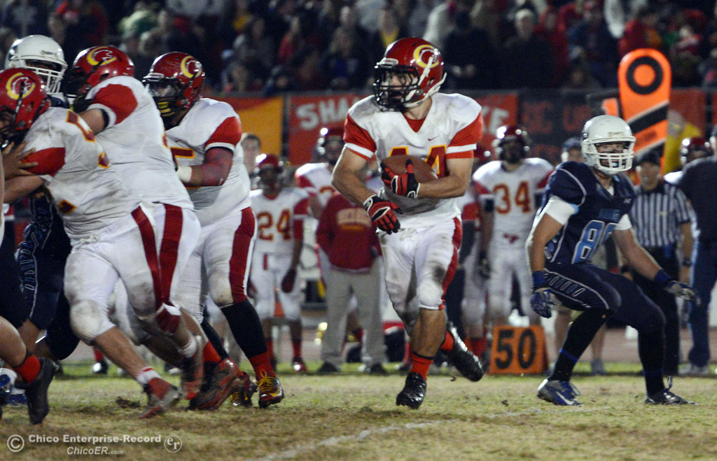 Description of . Chico High\'s #44 Paolo DiSano rushes against Pleasant Valley High in the third quarter of their Almond Bowl football game at CSUC University Stadium Friday, November 1, 2013 in Chico, Calif.  (Jason Halley/Chico Enterprise-Record)