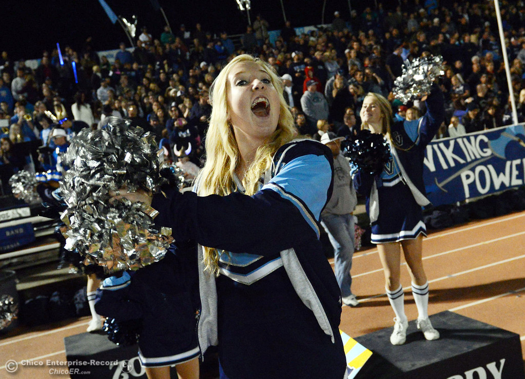 Description of . Pleasant Valley High cheerleader cheers on against Chico High in the second quarter of their Almond Bowl football game at CSUC University Stadium Friday, November 1, 2013 in Chico, Calif.  (Jason Halley/Chico Enterprise-Record)