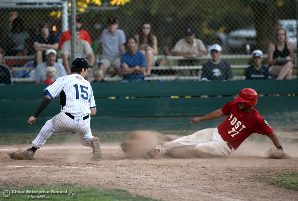 Description of . Chico Nuts' #15 Ryan Dufort (left) is unable to place the tag at home plate against Yolo Post 77's #6 Enrique Gonzalez (right) who slides in safely to score in the top of the fourth inning during their American Legion baseball game at Doryland Field Thursday, July 18, 2013 in Chico, Calif.  (Jason Halley/Chico Enterprise-Record)