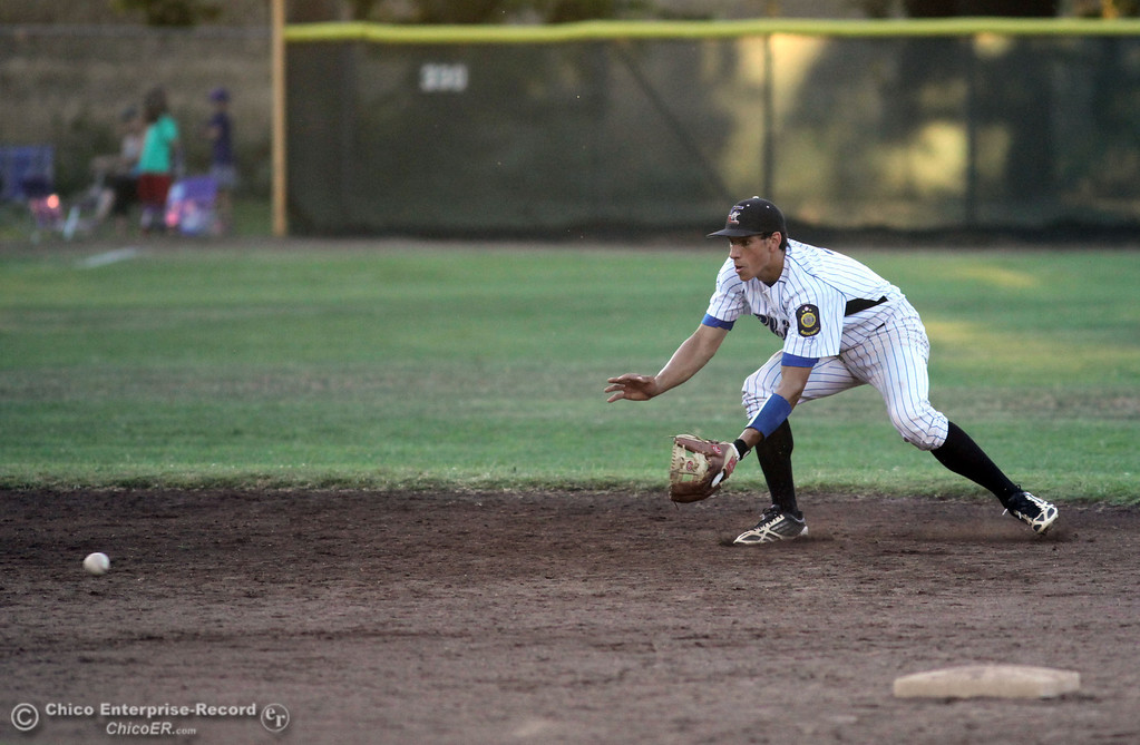 Description of . Chico Nuts' #7 Ryan Souza attempts to field the ball against Yolo Post 77 in the top of the fourth inning during their American Legion baseball game at Doryland Field Thursday, July 18, 2013 in Chico, Calif.  (Jason Halley/Chico Enterprise-Record)