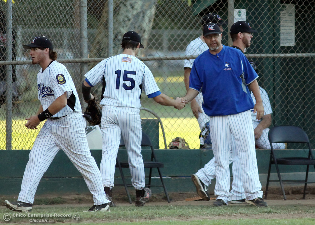 Description of . Chico Nuts' head coach Tom Stevens (center) congratulates the team ending the top of the third inning against Yolo Post 77 during their American Legion baseball game at Doryland Field Thursday, July 18, 2013 in Chico, Calif.  (Jason Halley/Chico Enterprise-Record)