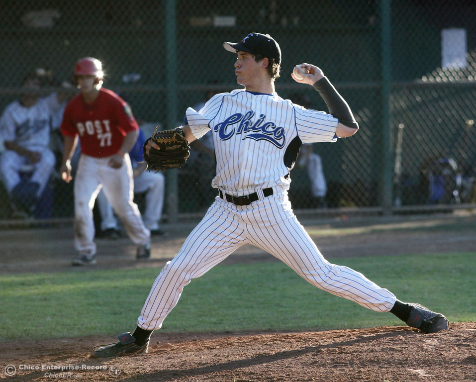 Description of . Chico Nuts' #15 Ryan Dufort pitches against Yolo Post 77 in the top of the first inning during their American Legion baseball game at Doryland Field Thursday, July 18, 2013 in Chico, Calif.  (Jason Halley/Chico Enterprise-Record)