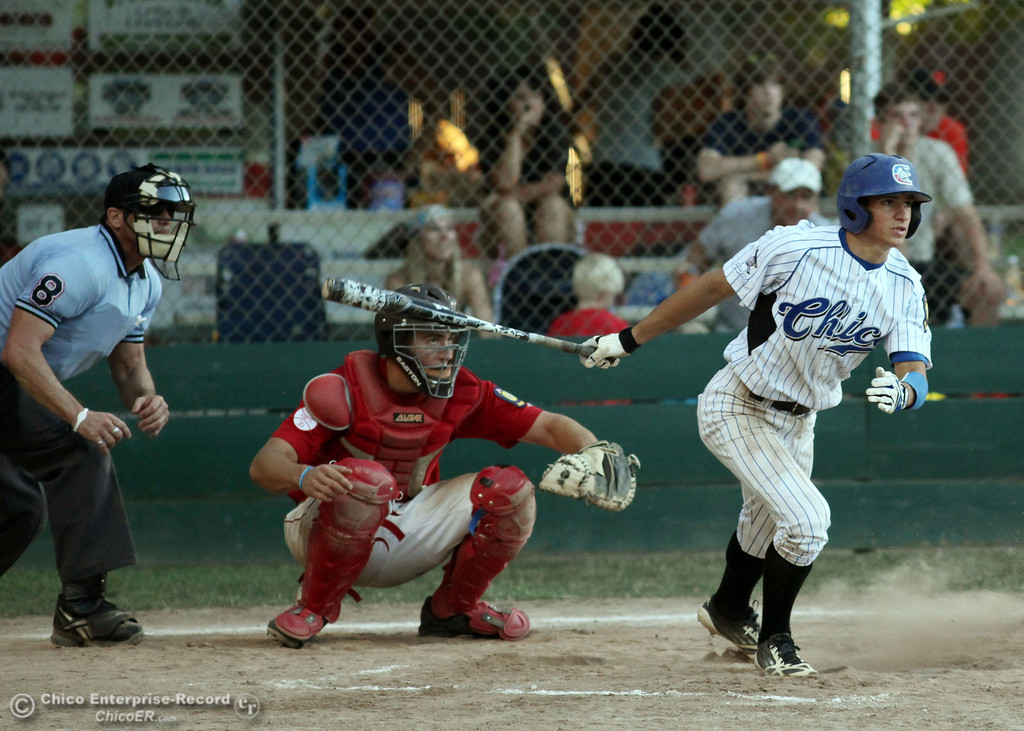 Description of . Chico Nuts' #7 Ryan Souza attempts a single against Yolo Post 77 in the bottom of the third inning during their American Legion baseball game at Doryland Field Thursday, July 18, 2013 in Chico, Calif.  (Jason Halley/Chico Enterprise-Record)