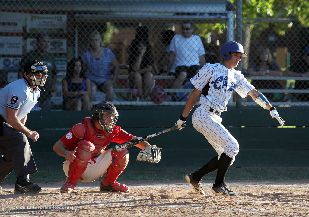 Description of . Chico Nuts' #7 Ryan Souza knocks a single against Yolo Post 77 in the bottom of the first inning during their American Legion baseball game at Doryland Field Thursday, July 18, 2013 in Chico, Calif.  (Jason Halley/Chico Enterprise-Record)
