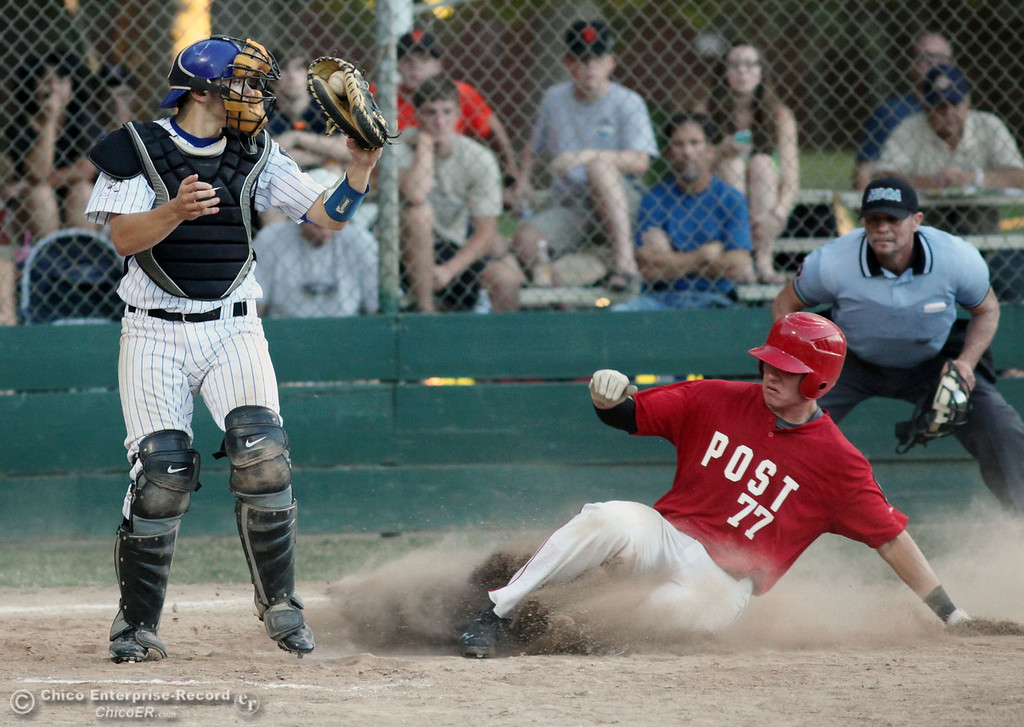 Description of . Chico Nuts' #9 Zach Visinoni (left) is unable to place the tag at home plate against Yolo Post 77's #25 Robert Young (right) who slides in safely to score in the top of the fourth inning during their American Legion baseball game at Doryland Field Thursday, July 18, 2013 in Chico, Calif.  (Jason Halley/Chico Enterprise-Record)