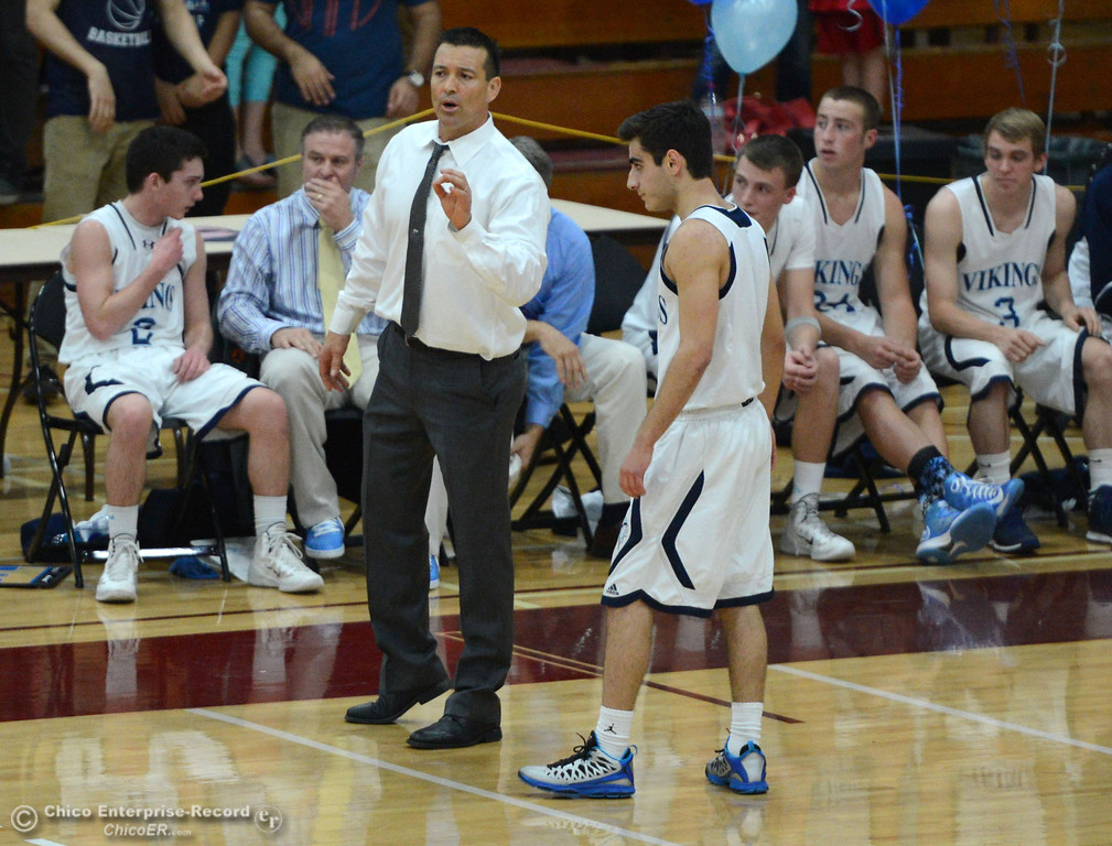 Description of . Pleasant Valley High coach Tim Keating (left) talks to #1 Joseph Abdulmasih (right) against Chico High in the second quarter of their boys basketball game at Acker Gym Saturday, March 8, 2014 in Chico, Calif.  (Jason Halley - Enterprise-Record)