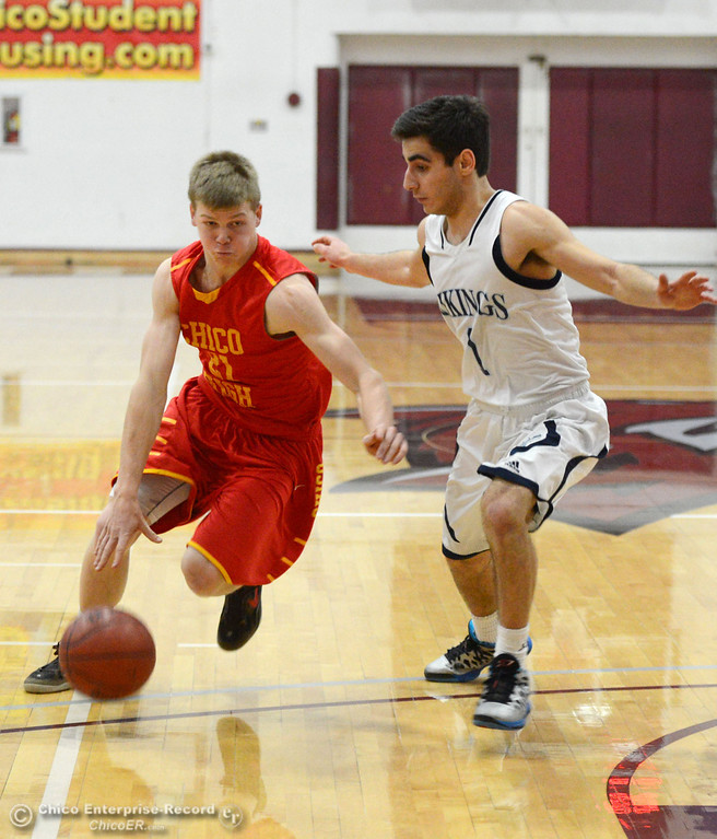 Description of . Chico High's #21 Hunter Mootz (left) dribbles against Pleasant Valley High's #1 Joseph Abdulmasih (right) in the fourth quarter of their boys basketball game at Acker Gym Saturday, March 8, 2014 in Chico, Calif.  (Jason Halley - Enterprise-Record)
