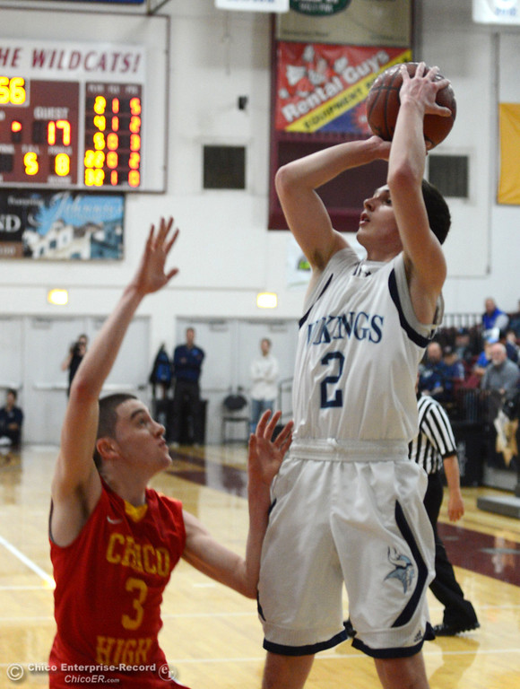 Description of . Pleasant Valley High's #2 Matt Urrutia (right) takes a shot against Chico High's #3 Spencer Hammer (left) in the second quarter of their boys basketball game at Acker Gym Saturday, March 8, 2014 in Chico, Calif.  (Jason Halley - Enterprise-Record)