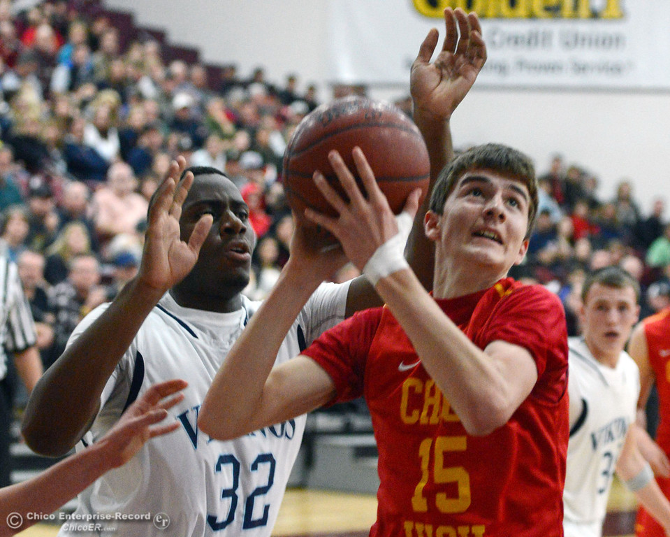 Description of . Chico High's #15 Jared Stidham (right) goes up for a shot against Pleasant Valley High's #32 Jevonne McClellan (left) in the first quarter of their boys basketball game at Acker Gym Saturday, March 8, 2014 in Chico, Calif.  (Jason Halley - Enterprise-Record)