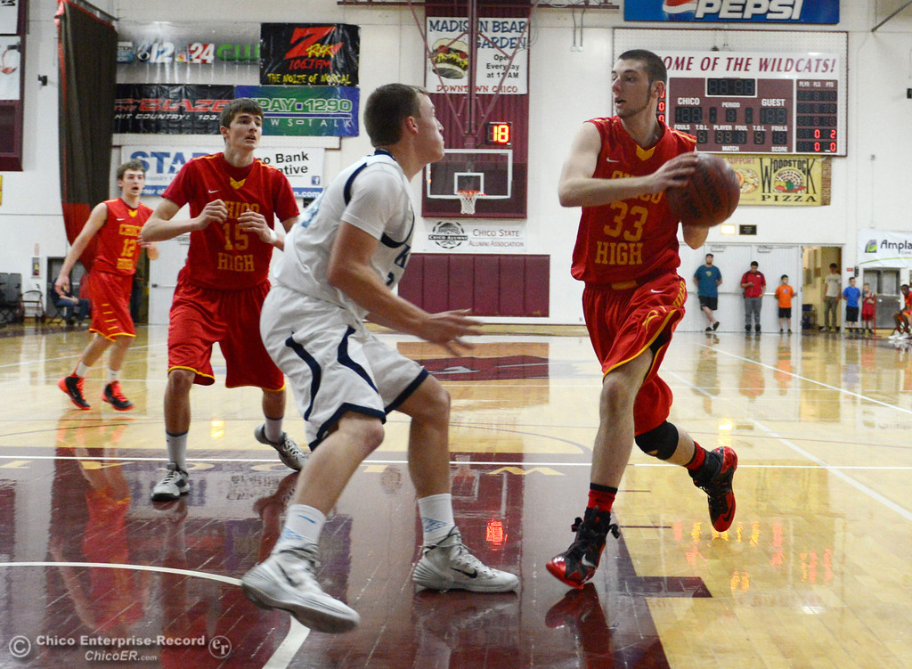 Description of . Chico High's #33 Devein Bauer (right) goes up for a shot against Pleasant Valley High's #34 Brandt Hughes (left) in the first quarter of their boys basketball game at Acker Gym Saturday, March 8, 2014 in Chico, Calif.  (Jason Halley - Enterprise-Record)